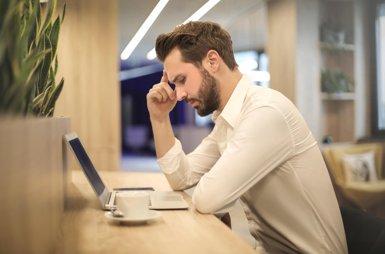 Man suffering from migraine headache