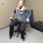 Woman sitting on wobbly chair